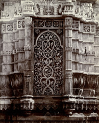 Close view of carved stone niche at the base of the minaret of the Nagina Masjid, Champaner 1860